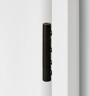 3-part wooden door hinge in the surface graphite black, shown in a white wooden door frame